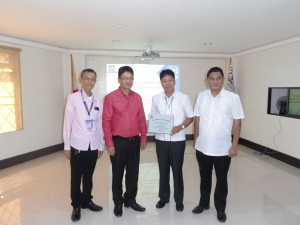 CSCRO6 Director IV Rodolfo B. Encajonado (second from left) together with Director III Raymund F. Gonzales (left) give the Certificate of Recognition to the Department of Environment and Natural Resources RO6.